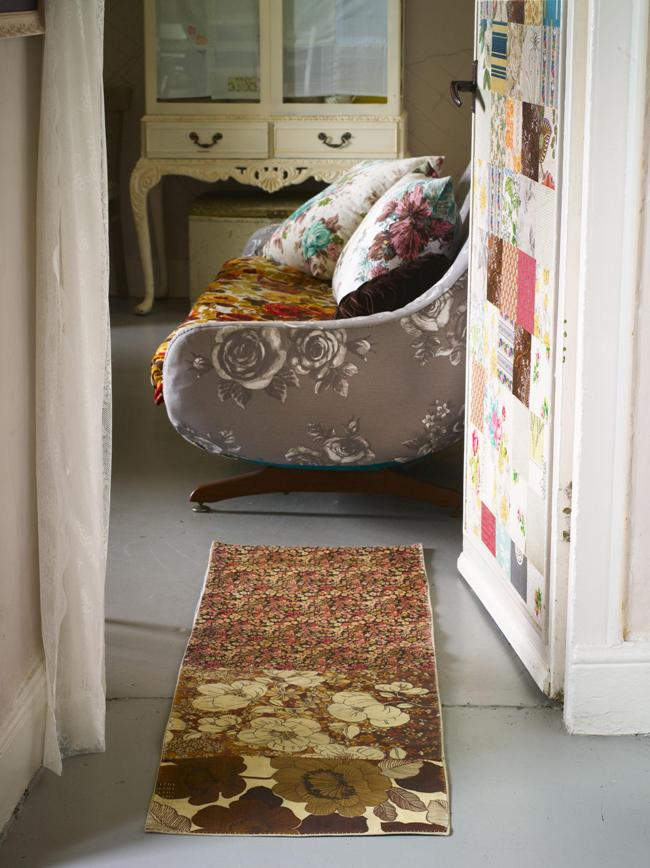 The door covered with a patchwork of wallpaper