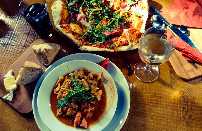 The Buccaneer fish stew and the Parma ham pizza.
