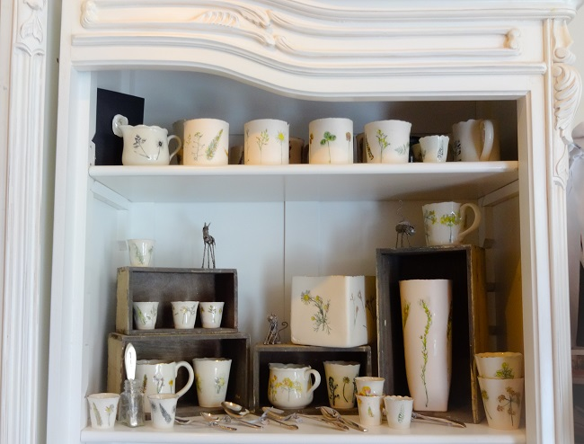 A display of pottery for sale in Susan Gaunt Boutique.