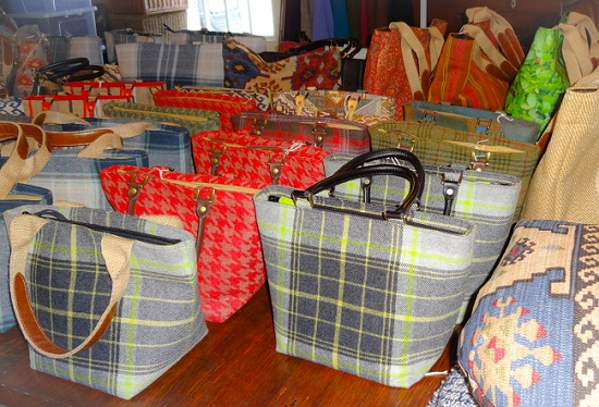 The tweed handbags are £65 (and you can buy longer straps to turn them into shoulder bags).