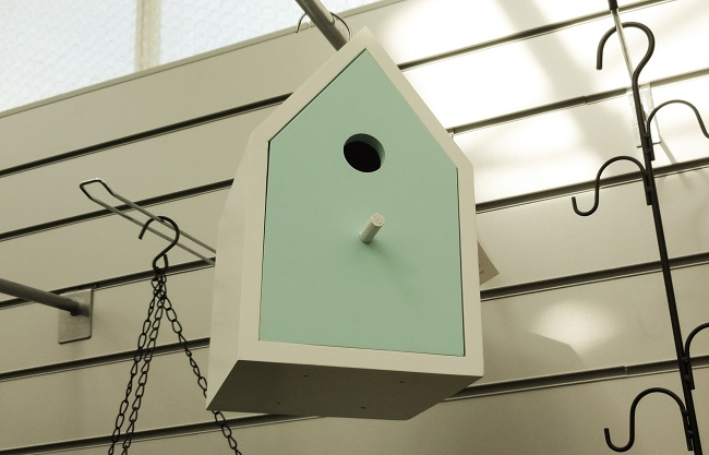 Wooden blue and white bird house, £19.95 at Crimple Hall Garden Centre in Harrogate.