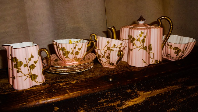 I think this pink scalloped edge teaset with gilt painted flower design is from the 1920s, but I don't know. There is an amazing large ceramic tray to go with it.