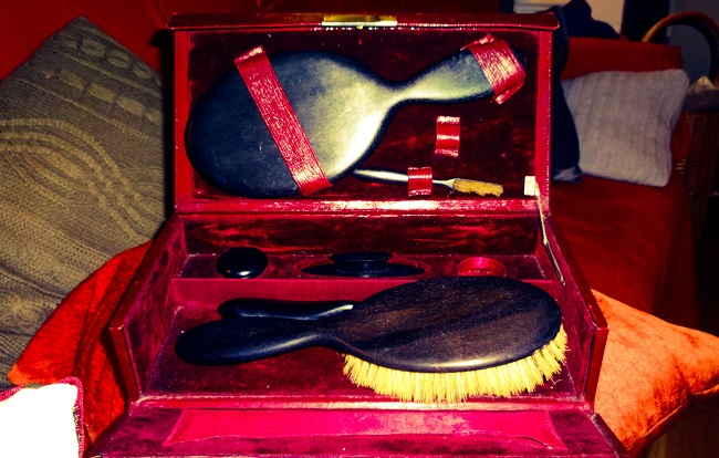 From Ella's Attic: a grooming set (I think) marked Boots Toilet Dept, with ebony brushes.