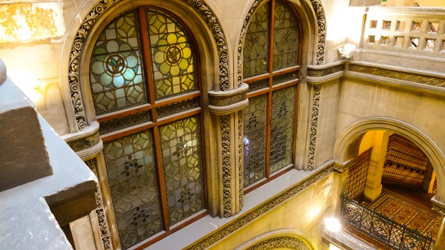 The lovely stone stairwell and stained glass windows at Leeds Central Library.