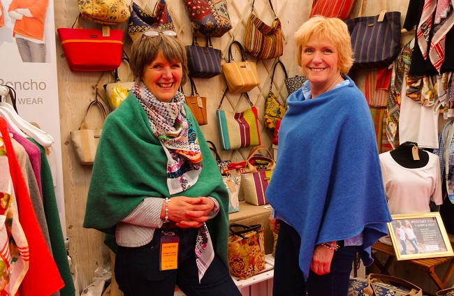 Alison and Ruth from Umpie Bags on their stand, wearing their ponchos.