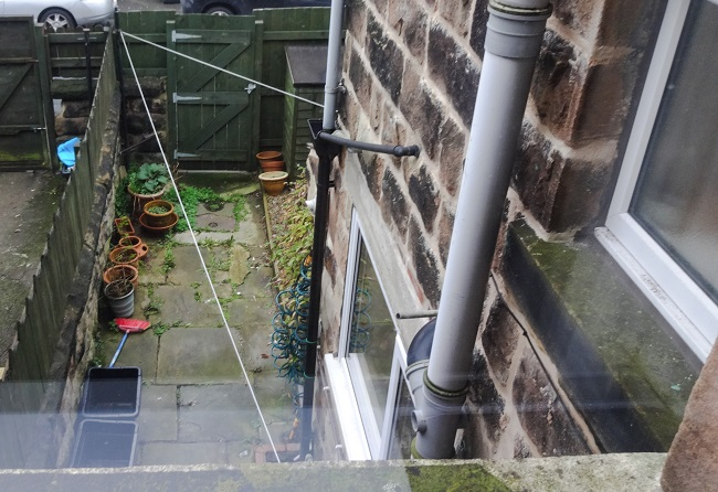 The back yard before was a bit of a mess but, after a bit of persuading on my part, we kept the Yorkshire flagstones.