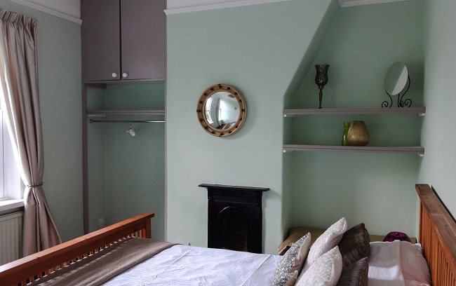 The main bedroom was fine. We weren't crazy about the pale green walls, but it's restful so we left it. We repainted the fireplace black and painted the cupboard doors in Dove Tail - we used a lot of Dove Tail.