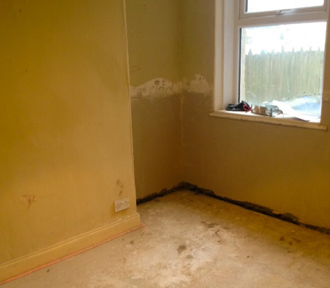 The dining room before, just after the damp proofing. Mess!