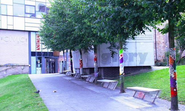 The Mandela Gardens outside the Barnsley Civic, where trees got the yarn bombing treatment.