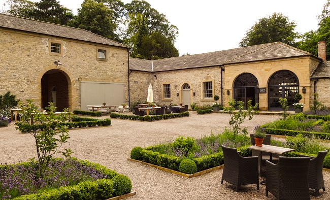 The Coach House Restaurant and courtyard at Middleton Lodge.