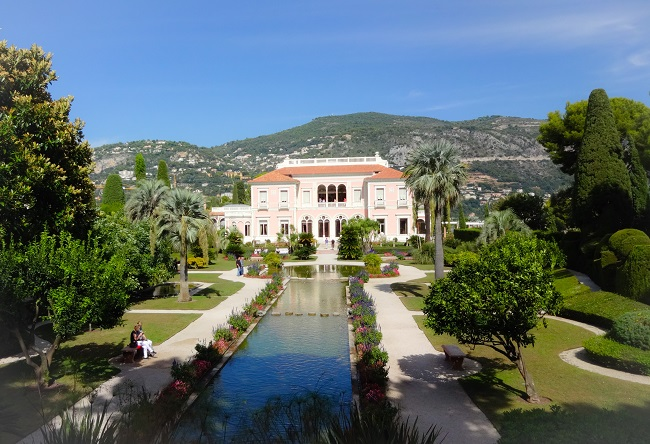 The Villa Ephrussi is all its Italianate rose-pink splendour.