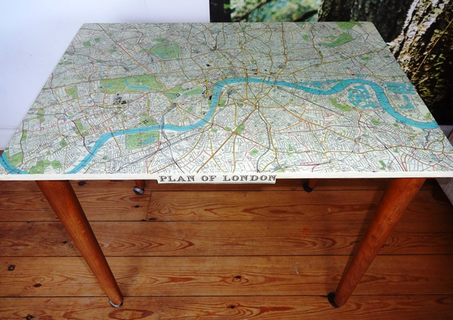 This map table works as a side table or as children's desk.